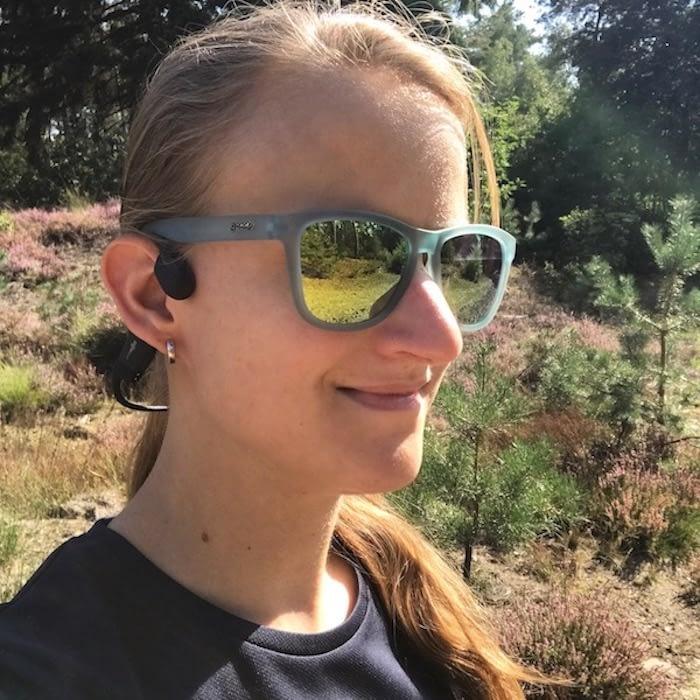 client using bone conduction headphones australia brand MXT with glasses