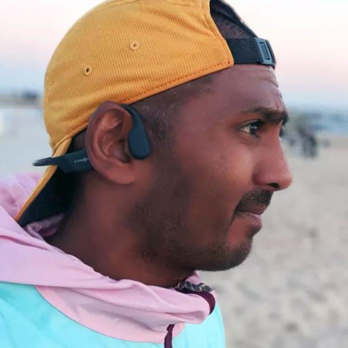 running bone conduction headphones at australia beach